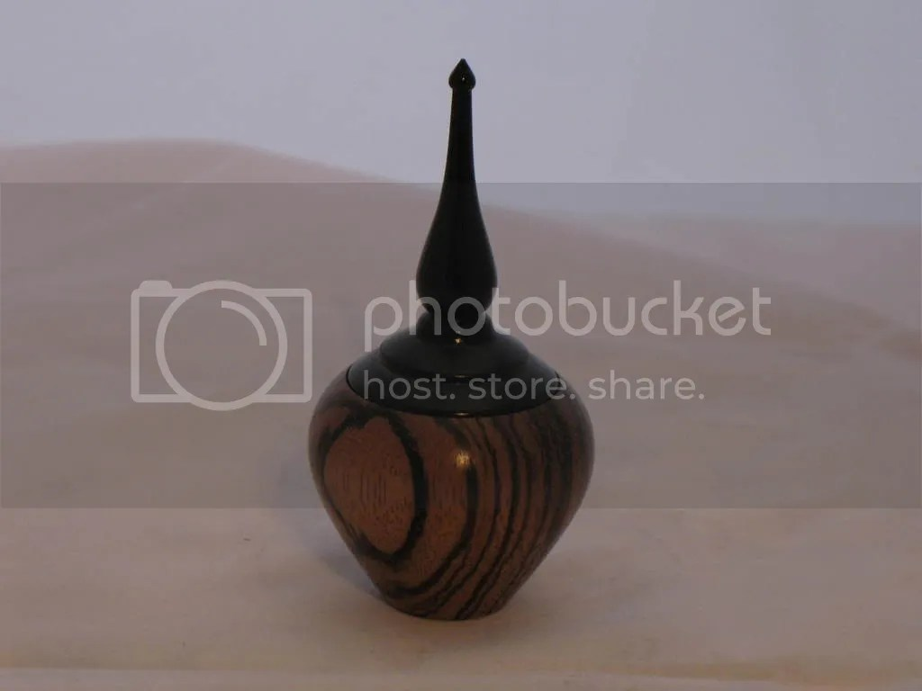 Very small box, zebra wood with black dyed finial lid