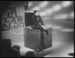 Brian Epstein on Hullabaloo, sitting on cube