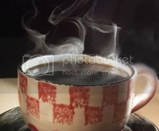 smelling-coffee-as-good-as-drinking.jpg steaming cup image by smoke_susan