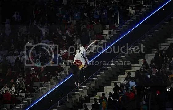 HE Sheikh Mohammed Bin Hamad Al-Thani races up the ramp on horseback to light the flame
