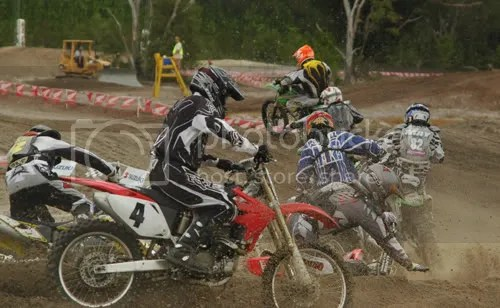 The day-glo helmet of Mr. Rick Bigalow with the holeshot