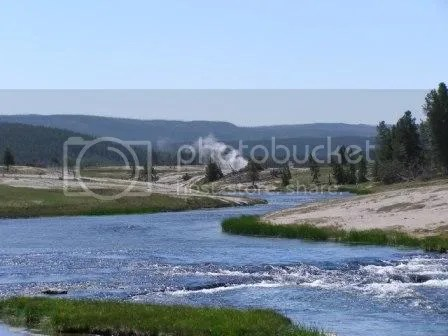 Image of a creek in a small, distant village