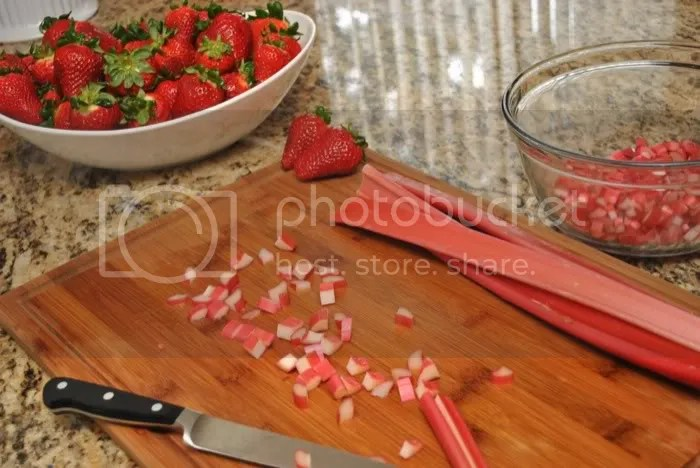 Chopping up strawberries and rhubarb