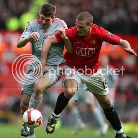 Steven Gerrard challenges Nemanja Vidic