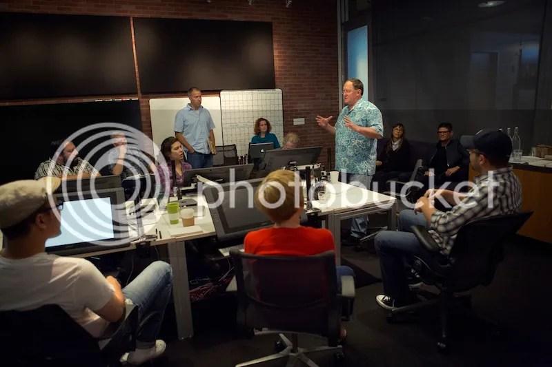 Director John Lasseter works with members of his story team on Disney•Pixar's