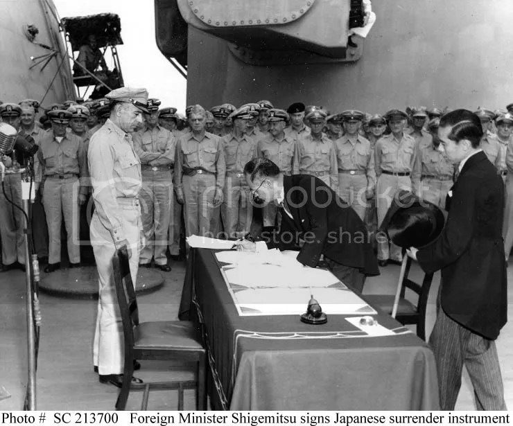 Foreign Minister Shigemitsu signs the document of formal surrender on September 02, 1945, aboard the battleship, USS Missouri.