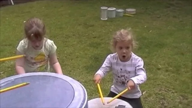 Girls playing drums - with rock & roll attitude!