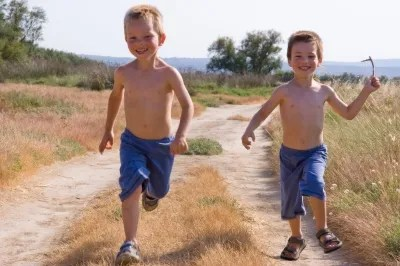 image of Two children running