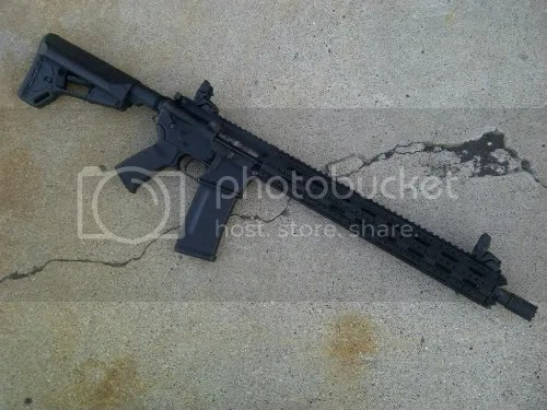 Free floated M4 profile barrel with a Troy Claymore muzzle brake