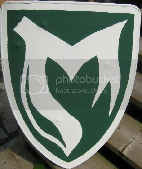 Vert, a maunche within a bordure argent.