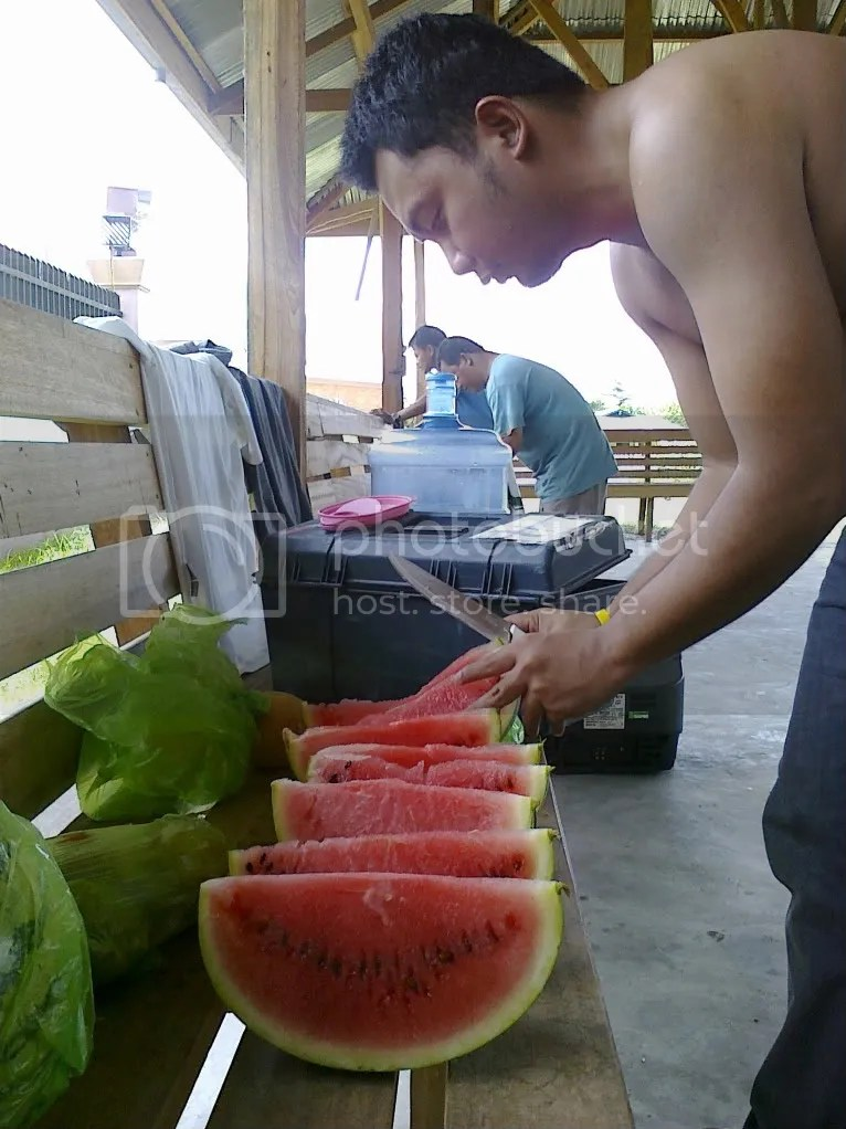 Mel Estallo halving watermelons