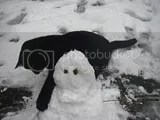 Tinks playing with snowman