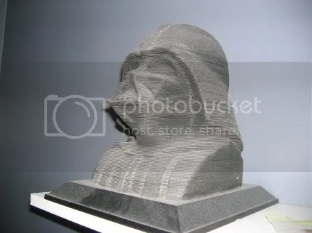 This is a 3D Puzzle Sculpture of the Lord of the Sith, Darth Vader (after all the burning and arms cut off and reattached).