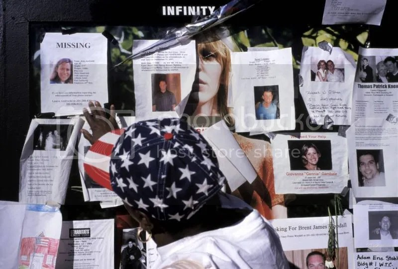 Small posters of missing loved ones line NYC streets.