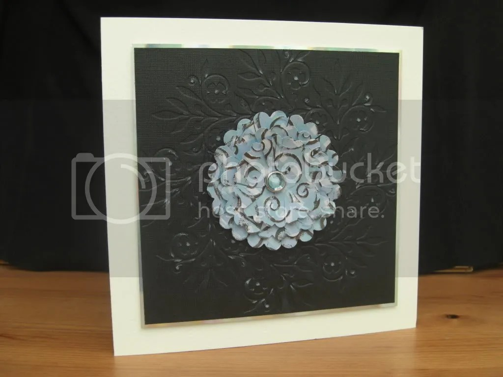 Embossed card with flower