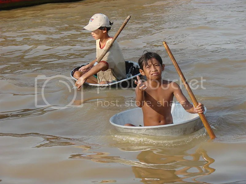 Child Beggars in Tonle Sap Lake, Cambodia