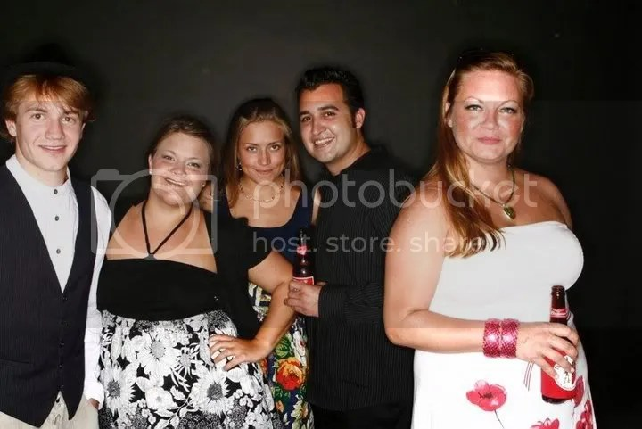 Me with friends at a wedding in June 2009