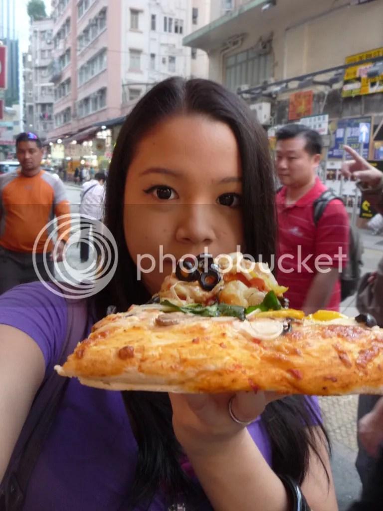 Lara Novales eating huge Vegetarian Pizza from Paisano's Pizzeria at Wan Chai Hong Kong