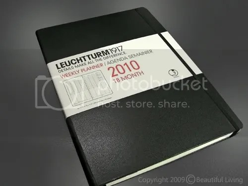 "Leuchtturm's Master Book Planner Measures a whopping 8¾"" x 12½"" and is at home on your desk or table. Thee size is also consistent with a laptop computer and may fit comfortably in your laptop bag along with your computer."