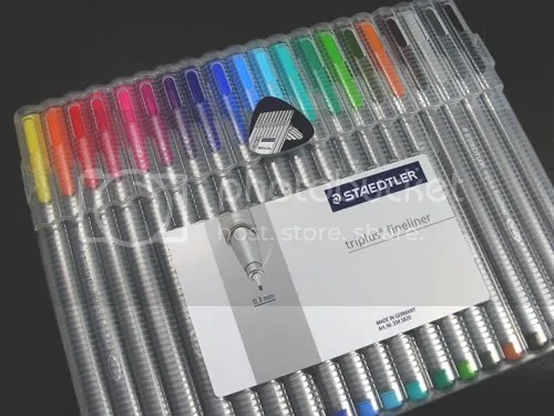 There are 20 Triplus Fineliners packaged in a case that doubles as a pen stand.