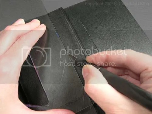 I cut slits in the Moleskines front and back covers that were 4 tall and 3/4 away from the spine. The slit was centered vertically so they would be at the same height on both sides.
