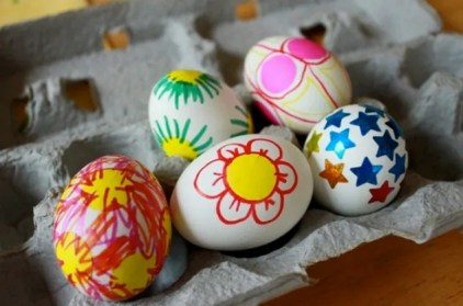 Decorating eggs with markers and stickers