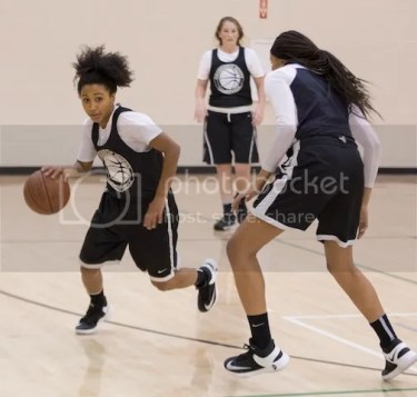 Heleyna Hill, left, pushes the ball up the floor during a Mitty November practice.