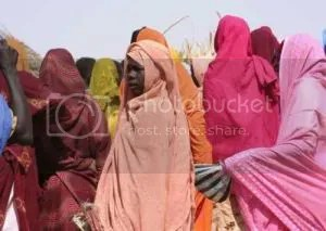 VIOLENCE OFTEN PREVAILS -- Although physical violence and sexual violence are easier to see, many women consider psychological abuse and humiliation even more devastating than physical violence. The photo shows women at a refugee camp at Tawilah, north Darfur in 2007. (Sipa Photo via Newscom)