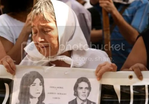 Mother of Plaza de Mayo with photos of missing children