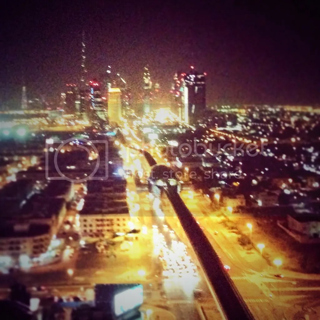 The breathtaking view from the rooftop of the Park Regis Kris Kin hotel (which was just a floor above the restaurant)