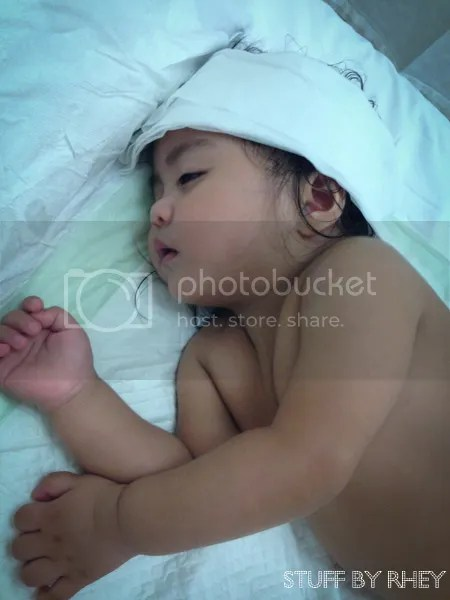 baby lying in the hospital bed, sick baby