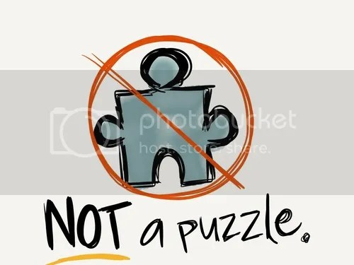 """A puzzle piece meant to resemble the Autism Speaks logo as if hand drawn, with a red """"no"""" sign over it. Underneath there are black letters which say """"NOT a puzzle."""""""