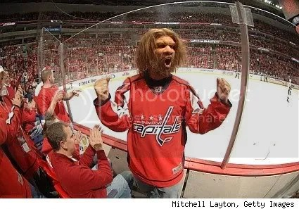 Geico loves the Caps, but when they put the caveman in a Caps jersey, its hard to tell just who it is!