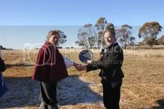 The Reverend presenting the Plate to Bear