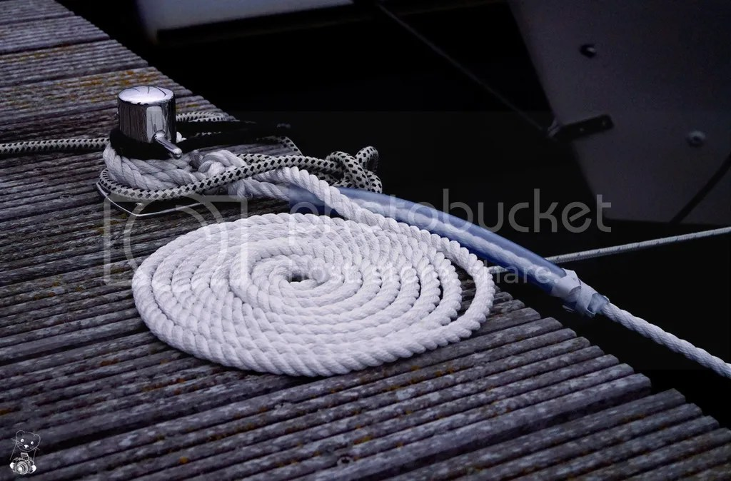 White rope on the dock at the Bay in Wiek in Germany, Rügen Island, Baltic Sea