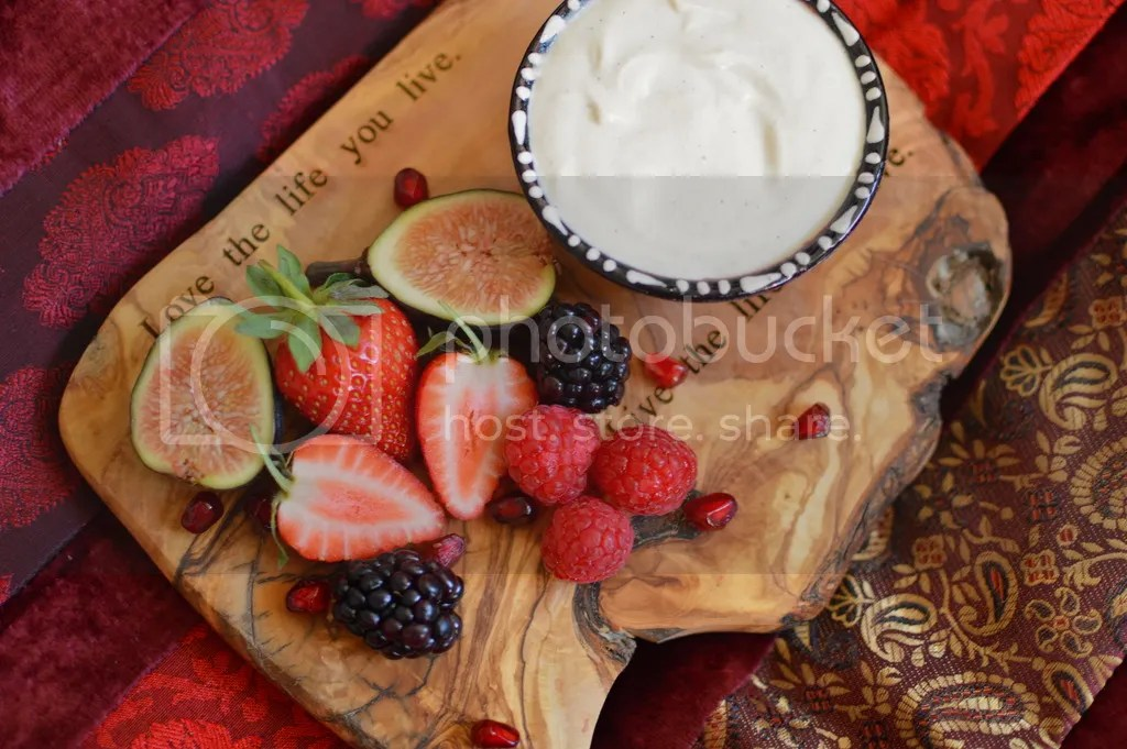 Raw vanilla maple cashew cream with summer fruits.
