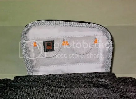 Memory card pockets under quick-access flap