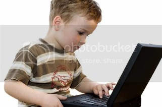 Five Year Old Boy Using Laptop Computer