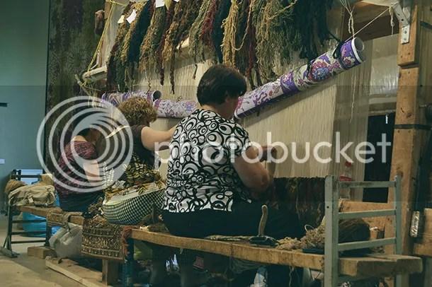 Three Armenian women weaving a carpet, Yerevan, Armenia.
