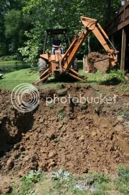 backhoe digging koi pond