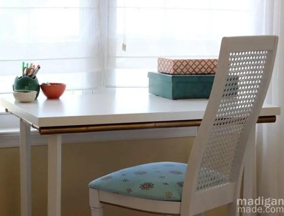 Customize an IKEA desk with gold bamboo trim. - madiganmade.com