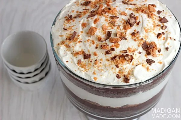 Candy bar and chocolate layered trifle dessert with Butterfinger candy