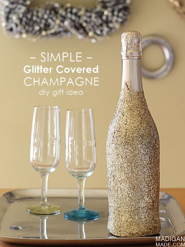 "Simple glitter covered champagne bottle - what a fun and easy way to ""wrap"" a bottle for a hostess gift."