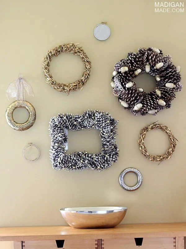 Hang a bunch of gold and silver wreaths on the wall for easy decor