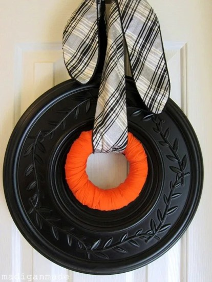 black, white and orange wreath from a ceiling medallion