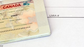 Canadian working visa and LMIA, Labour Market Impact Assessment paper document.