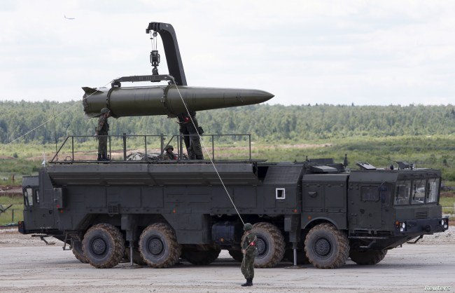 FILE - Russian servicemen equip an Iskander tactical missile system at the Army-2015 international military-technical forum in Kubinka, outside Moscow, Russia, June 17, 2015.