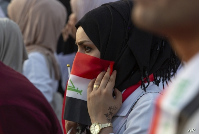 Students take part in an anti-government protest in Basra, Iraq, Wednesday, Oct. 30, 2019. (AP Photo/Nabil al-Jurani)