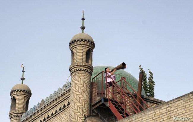 Imam calls Muslim Uighurs for afternoon prayer in China's Xinjiang region (2012 photo)