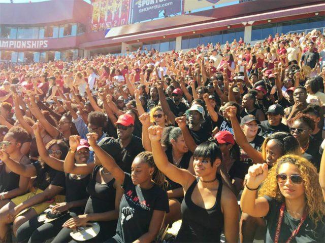 Florida State University students sit during national anthem, Oct. 8. Florida State University students sit during national anthem, Oct. 8.